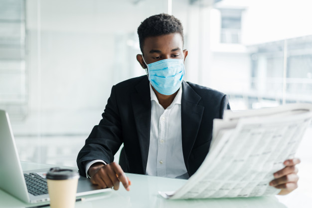 A man wearing a face mask in the office
